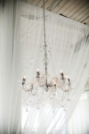 crystal chandelier with white drapery | Lavish Greek Wedding by Pravda Events | Photography by Barbie Hull